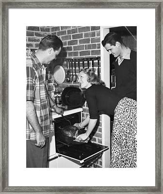 Cooking A Thanksgiving Turkey Framed Print