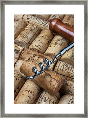 Corkscrew On Corks Framed Print by Garry Gay