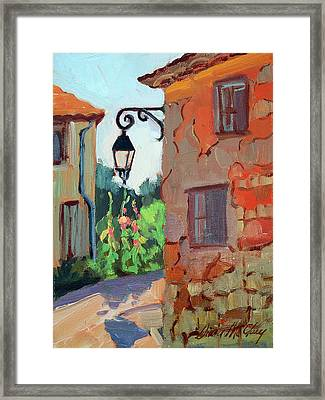 Street Corner In St. Colombe Framed Print by Diane McClary