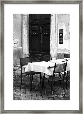 Corner Table Framed Print by John Rizzuto