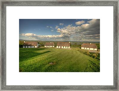 Corofin Thatched Cottages Framed Print by John Quinn