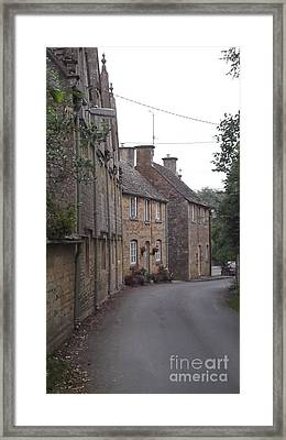Cotswold Cottages Framed Print by John Williams