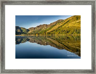 Cottage By The Lake Framed Print by Adrian Evans
