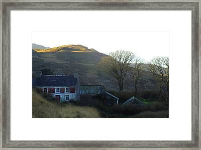 Cottage On Hillside Framed Print