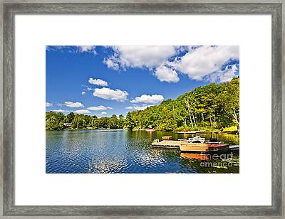 Cottages On Lake With Docks Framed Print
