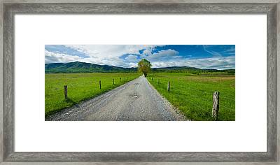 Country Gravel Road Passing Framed Print by Panoramic Images