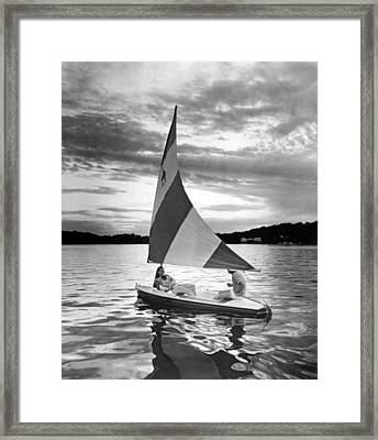 Couple Enjoys A Sunset Sail Framed Print by Underwood Archives