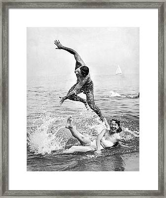 Couple Frolics In The Surf Framed Print by Underwood Archives