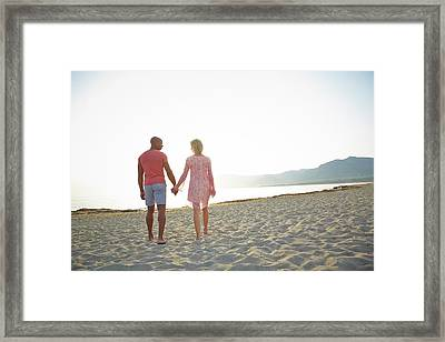 Couple Holding Hands Framed Print