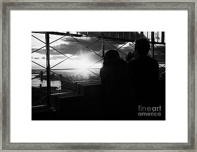 Couple Look At The View From Observation Deck 86th Floor Empire State Building New York City Framed Print by Joe Fox