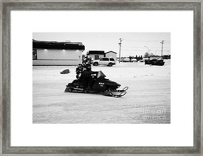 couple on a snowmobile Kamsack Saskatchewan Canada Framed Print by Joe Fox