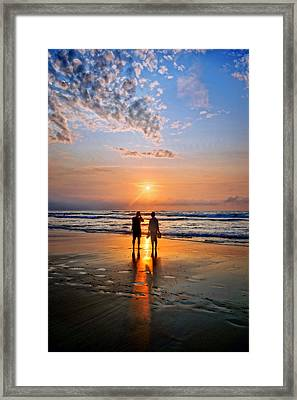 Couple On Beach At Sunset Framed Print by Mikel Martinez de Osaba