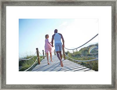 Couple On Boardwalk On Holiday Framed Print