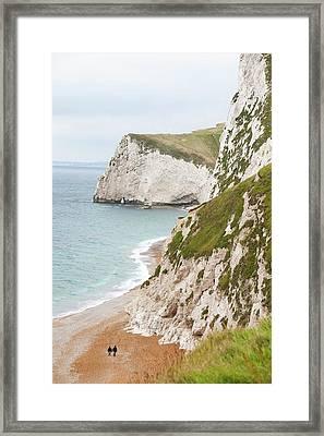 Couple On The Beach Near Lulworth Framed Print