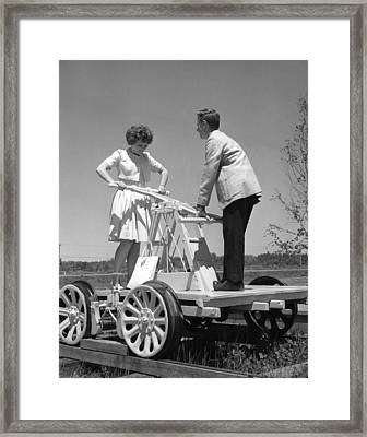 Couple Powers A Railroad Cart Framed Print by Underwood Archives