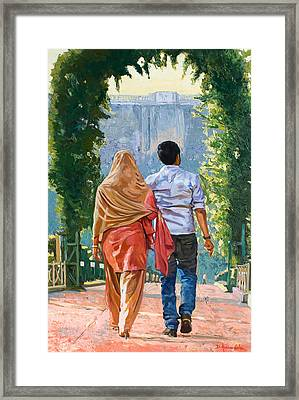Couple Under The Leafy Arch Framed Print by Dominique Amendola
