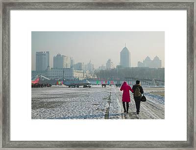Couple Walking On A Frozen River Framed Print