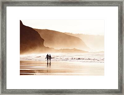 Couple Walking On Beach With Fog Framed Print by Mikel Martinez de Osaba