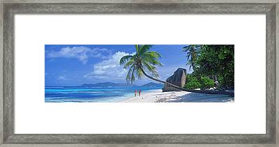 Couple Walking On The Beach, Anse Framed Print