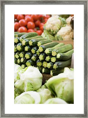 Courgettes, Lettuces, Cauliflowers And Tomatoes At A Market Framed Print