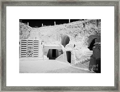 courtyard and steps leading to caves of the Sidi Driss Hotel underground at Matmata Tunisia scene of Star Wars films with film props Framed Print
