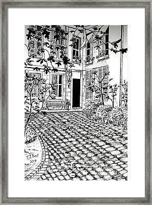 Courtyard Rue Saint Louis En L'isle Framed Print by Janice Best