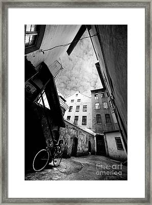 Courtyard With Bike And Buildings In Black And White Framed Print