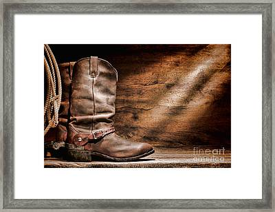 Cowboy Boots On Wood Floor Framed Print by Olivier Le Queinec