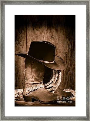 Framed Print featuring the photograph Cowboy Hat And Boots by Olivier Le Queinec