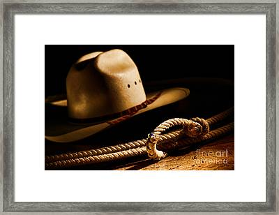 Cowboy Hat And Lasso Framed Print by Olivier Le Queinec