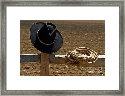 Cowboy Hat And Rope On Fence Framed Print