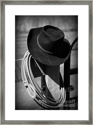 Cowboy Hat On Fence Post In Black And White Framed Print by Paul Ward