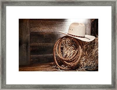 Cowboy Hat On Hay Bale Framed Print by Olivier Le Queinec