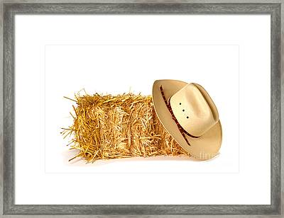 Cowboy Hat On Straw Bale Framed Print by Olivier Le Queinec