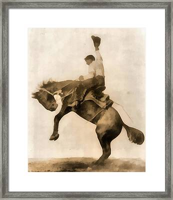 Cowboy On Bucking Bronco Framed Print by Dan Sproul