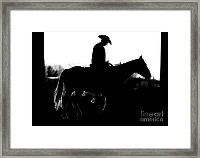 Framed Print featuring the photograph Cowboy Rides Home In Silhouette by Lincoln Rogers