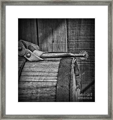 Cowboy Themed Wood Barrel And Spur In Black And White Framed Print by Paul Ward