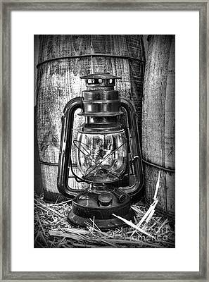 Cowboy Themed Wood Barrels And Lantern In Black And White Framed Print by Paul Ward