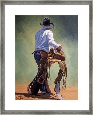 Cowboy With Saddle Framed Print by Randy Follis