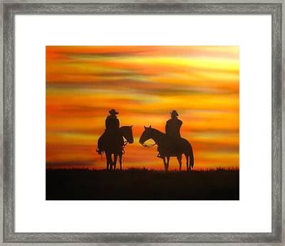 Cowboys At Sunset Framed Print