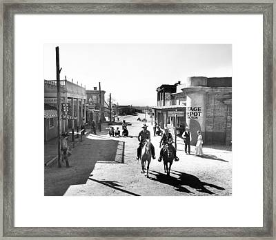 Cowboys Come Into Town Framed Print