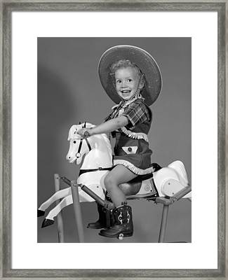 Cowgirl On Rocking Horse, C.1950s Framed Print by B. Taylor/ClassicStock