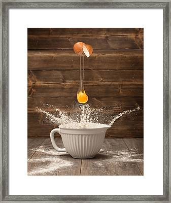 Cracking The Egg Framed Print by Amanda Elwell