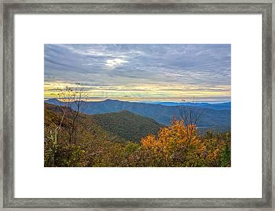 Craggy Sunrise Framed Print by John Haldane