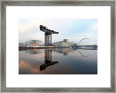Crane And Bridge Reflection  Framed Print by Grant Glendinning