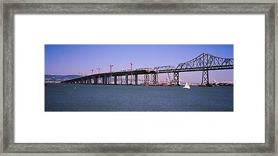 Cranes At A Bridge Construction Site Framed Print by Panoramic Images