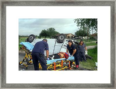Crash Victim Being Treated Framed Print by Jim West
