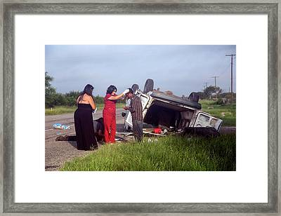Crash Victims Being Treated Framed Print by Jim West