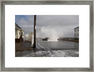 Crashing Over The Wall Framed Print by Eugene Bergeron