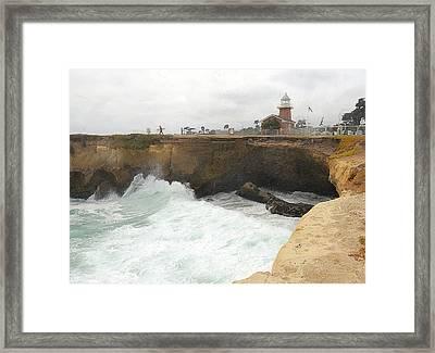 Crashing Surf Near The Lighthouse Framed Print by Ron Regalado